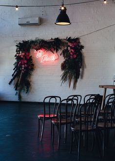 Floral wedding arbour with Til Death neon sign