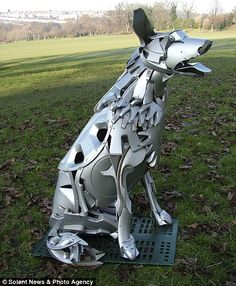 A dog with a steel grip...GSD Art | Another hubcap design