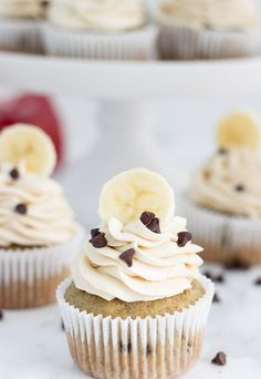 A moist banana cupcake is dotted with mini chocolate chips and topped with a sweet peanut butter frosting making these chocolate chip banana cupcake a delight!
