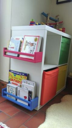 Ikea Kallax with painted ikea spice racks for books.