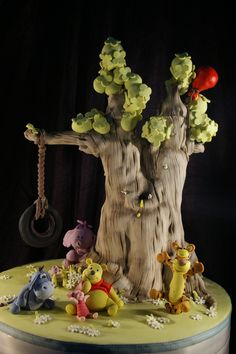This cake is absolutely too cute! Maybe I'll do a WTP theme for Mai's birthday! Luca's Winnie the Pooh Tree Cake by Dot Klerck Crazy Cakes, Fancy Cakes, Cupcakes, Cupcake Cakes, Winnie The Pooh Cake, Croquembouche, Friends Cake, Tree Cakes, Think Food