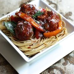 Italian Turkey Sausage Meatballs & Peppers - Hot Italian turkey sausage adds a kick of heat to these classic Italian meatballs with sautéed bell peppers over spaghetti.  #ItalianFood #TurkeySausage