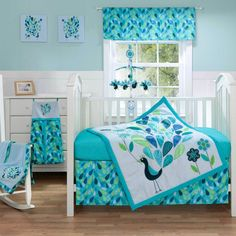 This three-piece bedding set is an ideal shower gift for the baby who has everything. A comforter, crib skirt and fitted sheet are decked out in a peacock blue color theme in blended cotton and polyester for incredible comfort and easy care.
