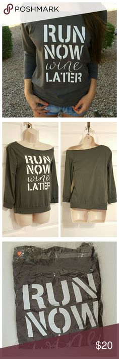 """Run Now Wine Later"" Graphic Tee 🔻 PRICE DROP New without tags, in package. 3/4 sleeve t-shirt. Casual top with ""Run Now Wine Later"" graphic print. Cute angled wide neck cut with ripped style. Cotton blend.   Measurements laying flat:  36"" Relaxed Bust  16.5"" Flat Waist  23"" Length from shoulder to bottom waist hem Tops Tees - Long Sleeve"