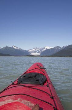 Glide through Alaskan waters by kayak.