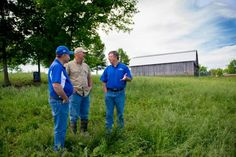Tommy Yankey, agriculture and natural resources extension agent in Anderson County, left, and Les Anderson, UK Beef specialist, right, are helping Mike Wilson, center, spend more time on his farm.