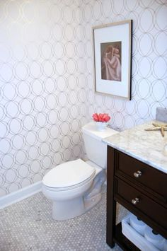 graham and brown geometric wallpaper, and marble hexagon tile.