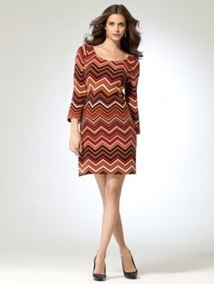 Pull over zig zag print sweater dress. 3/4 length sleeves. 35 3/4 inch body length 97% acrylic, 3% spandexLining: 95% polyester, 5% spandexMade in the USAMachine wash