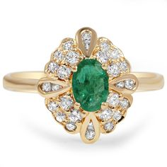 The Aleta Ring from Brilliant Earth. This yellow gold Retro-era ring features an oval shaped natural emerald encompassed by twenty eight round brilliant diamond accents. This piece is truly regal.