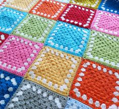 Color Inspiration :: Solid color granny squares with one round of white, crocheted by Jane of Teawagon Tales. White squares with one round of color would be pretty, too