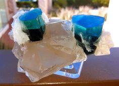 Gemmy blue Indicolite Tourmaline specimens on Quartz and Cleavelandite matrix have appeared in Tucson this year.