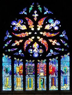 This stained glass window is full of bright colors. It is in St michael's church, Linlithgow, England and was designed by Crear McCartney to mark the 750th anniversary of the church in 1992