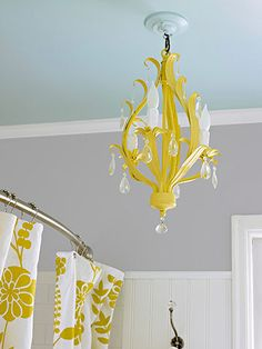 I am loving the chandelier look in unexpected rooms..this would be great for a guest bath and I LOVE the color