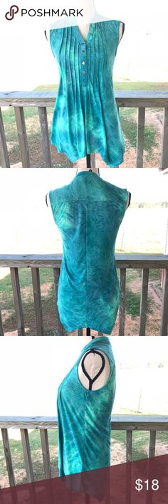 New Directions Sleeveless Blouse A beautiful New Directions Sleeveless blouse that is blue and sea foam green colors. No stains, tears, or holes. In EUC!  Material: • 93% polyester  • 7% Spandex new directions Tops Blouses