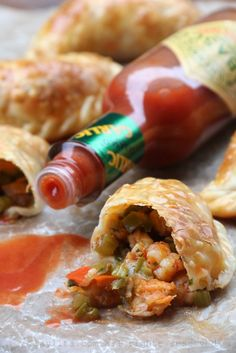 Recipe for langostino and Andouille sausage empanadas inspired by the flavors of Louisiana. These spicy empanadas can also be made with crawfish or shrimp, and are served with an avocado cilantro dipping sauce. Seafood Dishes, Fish And Seafood, Seafood Recipes, Mexican Food Recipes, Cooking Recipes, Seafood Empanadas Recipe, Tamales, Tostadas, Chorizo
