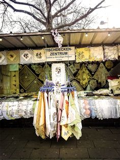 Table clothes center by Michaela Sibi - Vienna, streetmarket Floridsdorf, Franz Jonas-Platz:  A candid photography, which I changed only in a vintage style,  because I remember such market stands when I was child   and the annual market ...