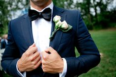 Dapper Black Tie Groom with a Rosebud Boutonniere| Erin Nicastro Photography