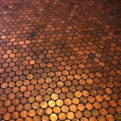 Glue copper pennies in place, fill in with black grout, seal with clear coat, and you have a cent-sational floor that will wow your guests.
