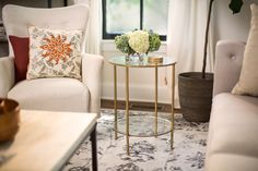 Bella Round Aged Gold Glass End Table with the Milton Arm Chair from Home Decorators Collection