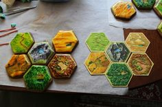 Settlers of Catan Cookies next to actual game pieces.  Settlers is new to some but it was first published in '95.  Mmm, Settlers of Catan…