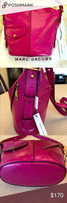"Marc Jacobs cross body bag This gorgeous Marc Jacobs leather cross body bag is 9"" tall 12"" wide at the top with a 22""adjustable strap. The color is called hydrangea, a really  beautiful pink! It's the perfect pop of color for spring. It has a zipper top closure and a pocket in the lining of the bag. This bag is brand new with the tags and comes with the dust bag. Marc Jacobs Bags Crossbody Bags"