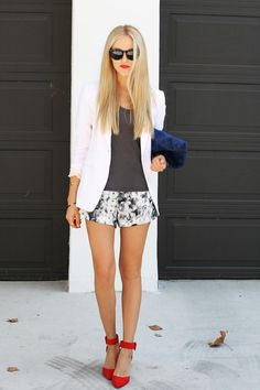 White jacket, grey-chrome shorts & poppy red ankle strap heels, furry navy blue purse clutch