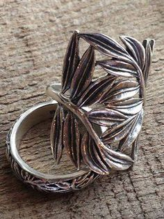 Love these two ring together.  Sterling Silver, the Paradise statement ring looks great on your index or middle finger and wear the band on your ring finger for a fabulous look!  Get the statement ring; you can easily get the band 1/2 off.