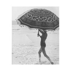 i want to run on the beach with a giant umbrella. that would be cool