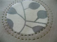 Shadow Applique circle at Stitching Life. Silk organza over a 2.5″ circle of loose-weave cotton print.