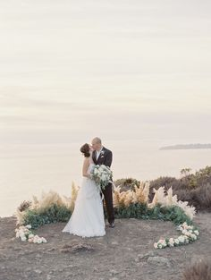 Photography : Michele Beckwith   Event Planning : Cindy Danbom   Floral Design : Angella Floral Arts   Dress : BHLDN Read More on SMP: http://www.stylemepretty.com/2017/03/11/oceanside-destination-elopement/