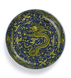 A blue-ground yellow-enamelled 'Dragon' dish, Mark and period of Kangxi (1662-1722)