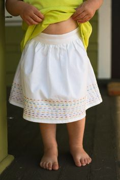 running stitch skirt. I might do this on a baby wrap, too