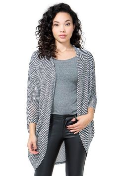 A spellbinding and cozy cocoon, featuring a black and white pattern throughout, Dolman sleeves with slim cuffs, and open front. Finished ends. $18.50