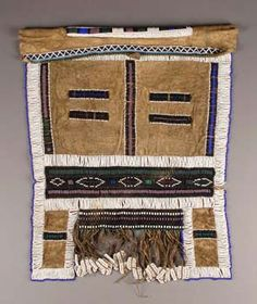 Africa | Beaded apron from the Nguni people of South Africa | These types of aprons arewornby unmarried women | Leather embroidered with glass beads.