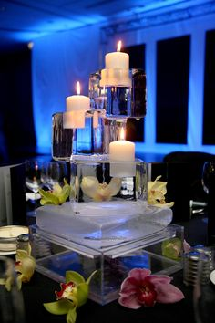 Ice sculptures as centerpieces with candles, adds a unique and classy touch.