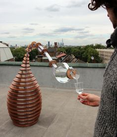 Tropism Well, an interactive sculpture that senses when someone is near and bows to pour water into their glass.