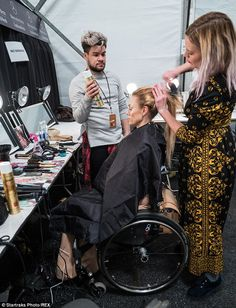 A model has her hair coiffed to perfection backstage at the diverse runway show...