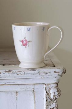 Tall Mug by Caroline Zoob in the Rose Tattoo design