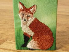 """Hand Stitched Fox: posted by Kris, on """"How Do You Make This?"""" The design of this fox embroidery is influenced by turn of the century naturalist illustrations and only uses two different stitches. In addition to the free pattern and photo tutorial, time lapse video of the process is included!"""