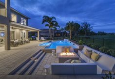 Relax into the evening as you enjoy the setting sun and a small bonfire to light the night. From Toll brothers at Eagle Creek, Stonehill Palm Beach model home in Orlando, Fla.