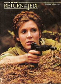 Leia, The Empire Strikes Back, on Endor with a gun