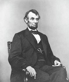 Civil War era photograph of President Abraham Lincoln sitting in a chair.