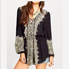 Free People Wildest Moments Blouse! Gorgeous boho blouse with an amazing flattering fit! Lace up tassel top with beautiful design on front and back of piece- cinched in at the waist- rounded hemline and peasant sleeves- lovely! Free People Tops Blouses