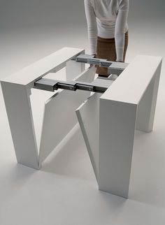 The Golietta is an expanding console to dining table with two self storing leaves.
