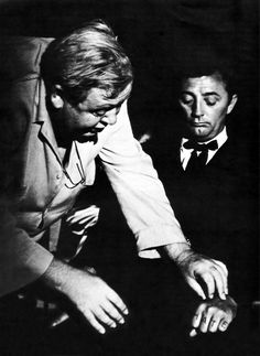 """Charles Laughton directing Robert Mitchum in """"The Night of Hunter"""", 1955.  This is a great movie.  Robert Mitchum is so good in this part."""