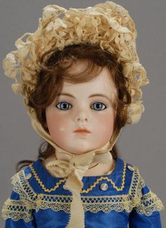 With a perfect, beautifully shaded bisque head and shoulderplate, it is the hypnotic blue paperweight eyes of this Bebe Bru Jeune 8 that an admirer