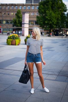 striped shirt, shorts, and white keds