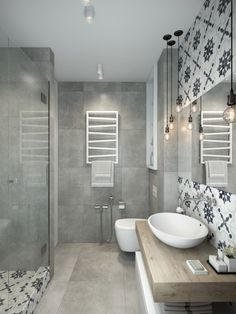Gorgeous bathroom! I love the soft greyscale color scheme of it, and the added patchwork tiles. They definitely make a statement within this space!