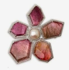Saskatchewan Tourmaline Flower Brooch, presented during an audience with the province's Lieutenant Governor on October 17, 2013. From Saskatchewan designer Rachel Mielke of Hillberg & Berk, 18K white gold brooch in the shape of a flower with five petals of Madagascar tourmaline in shades of pink with a central white fresh water cultured pearl, all surrounded by 300 diamonds (1.527 carats in all). Media reports placed the value of the brooch at $15,000.