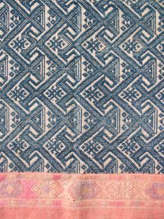 Sam Nuea - Indigo blue fabric with an intricately woven design. From Laos.